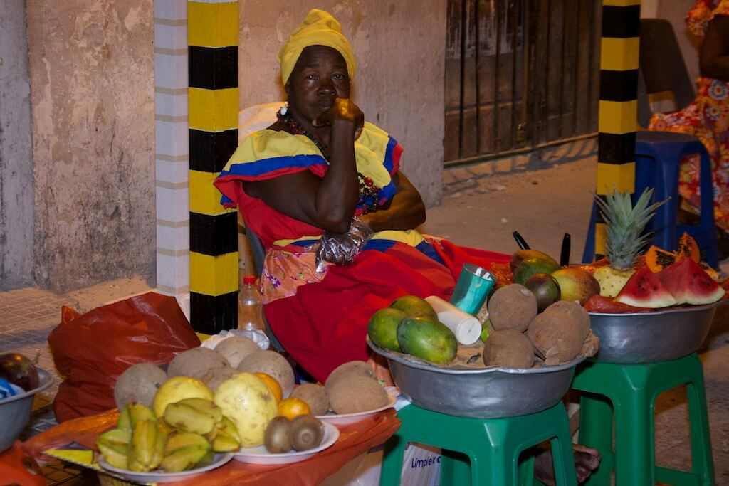 A street vendor wearing the colors of the Colombian flag